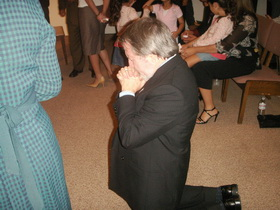 Eddie Praying after taking the final step in Foursquare licensing  and being ordained in 2007.
