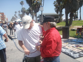 Praying for a man's healing on California's busy Venice Beach Promenade